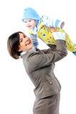 Επιχειρησιακή γυναίκα στο φέρνοντας μωρό κοστουμιών Στοκ φωτογραφία με δικαίωμα ελεύθερης χρήσης