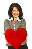 επιχειρησιακή καρδιά που προσφέρει τη γυναίκα Στοκ φωτογραφία με δικαίωμα ελεύθερης χρήσης