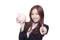 επιχειρησιακή piggy γυναίκα &ta Στοκ Εικόνα