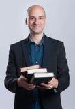 Επιχειρησιακό άτομο με τα βιβλία Στοκ εικόνα με δικαίωμα ελεύθερης χρήσης
