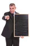 Επιχειρησιακό άτομο με τα διαθέσιμα σημεία χεριών πινάκων σε σας Στοκ φωτογραφία με δικαίωμα ελεύθερης χρήσης