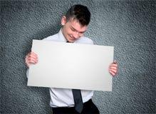 Επιχειρησιακό άτομο με το χαρτόνι Στοκ Εικόνες