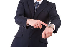 Επιχειρηματίας που δείχνει στο wristwatch του. Στοκ εικόνα με δικαίωμα ελεύθερης χρήσης