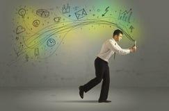 Επιχειρησιακό άτομο σε μια βιασύνη με τα εικονίδια μέσων doodle στοκ φωτογραφία με δικαίωμα ελεύθερης χρήσης