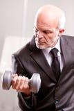 Επιχειρησιακό άτομο Weightlifting στη δράση Στοκ Εικόνες