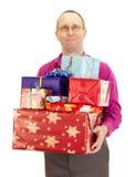 Επιχειρησιακό πρόσωπο με πολλά δώρα στοκ εικόνες