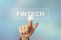 Επιχειρησιακό χέρι που χτυπά fintech ή οικονομικό κουμπί τεχνολογίας επάνω Στοκ Εικόνες