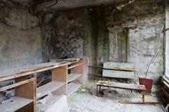 Ερήμωση στην αίθουσα του νοσοκομείου, εγκαταλειμμένη πόλη-φάντασμα Pripyat στη ζώνη αλλοτρίωσης πυρηνικού σταθμού του Τσέρνομπιλ, στοκ εικόνες