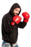 Ερασιτεχνικός μπόξερ που φορά ένα hoodie και τα γάντια Στοκ φωτογραφίες με δικαίωμα ελεύθερης χρήσης