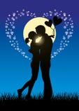 Εραστές που φιλούν το sihouette ζευγών Στοκ Εικόνες