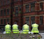 Εργάτες οικοδομών που παίρνουν ένα σπάσιμο Στοκ Εικόνες