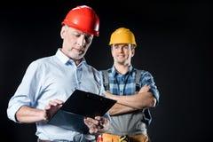 Εργάτης και αρχιτέκτονας με την περιοχή αποκομμάτων Στοκ εικόνες με δικαίωμα ελεύθερης χρήσης