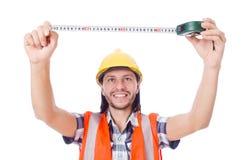 Εργάτης οικοδομών με την ταινία-γραμμή που απομονώνεται επάνω Στοκ Φωτογραφίες