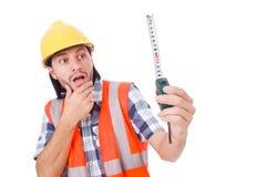Εργάτης οικοδομών με την ταινία-γραμμή που απομονώνεται επάνω Στοκ Εικόνες