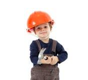 Εργάτης οικοδομών στο πορτοκαλί κράνος με το σφυρί στο λευκό Στοκ φωτογραφία με δικαίωμα ελεύθερης χρήσης