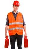 Εργαζόμενος ατόμων στο σκληρό καπέλο φανέλλων ασφάλειας με τα μεταλλικά κουτιά Στοκ φωτογραφία με δικαίωμα ελεύθερης χρήσης