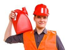 Εργαζόμενος ατόμων στο σκληρό καπέλο φανέλλων ασφάλειας με τα μεταλλικά κουτιά Στοκ Εικόνα