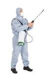 Εργαζόμενος ελέγχου παρασίτων με τον ψεκαστήρα φυτοφαρμάκων στοκ εικόνα με δικαίωμα ελεύθερης χρήσης