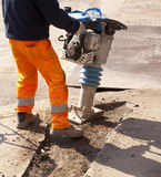 Εργαζόμενος με το κομπρεσέρ Στοκ Φωτογραφία