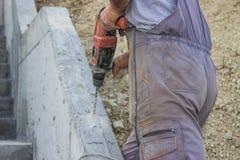 Εργαζόμενος που τρυπά 3 με τρυπάνι Στοκ Εικόνα