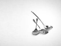 εργαλεία κουζινών ή εργαλεία κουζινών σε ένα υπόβαθρο Στοκ Εικόνα