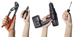 Εργαλεία στα χέρια στο άσπρο υπόβαθρο Στοκ Εικόνα