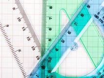 Εργαλεία σχεδίων σε μπλε χαρτί γραφικών παραστάσεων Στοκ φωτογραφίες με δικαίωμα ελεύθερης χρήσης