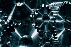 Εργαλεία χάλυβα ισχύος, cogwheels στο μπλε Στοκ Εικόνα