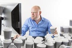 Εργατικός και επιχειρηματίας στο γραφείο στοκ εικόνα