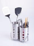 εργαλεία κουζινών ή εργαλεία κουζινών σε ένα υπόβαθρο Στοκ Φωτογραφία