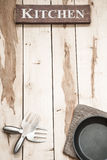 Εργαλεία κουζινών στο ξύλινο γραφείο Στοκ Φωτογραφίες