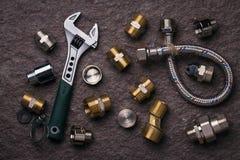 Εργαλεία υδραυλικών για τους κρουνούς Στοκ Εικόνα