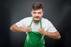Εργοδότης υπεραγορών πορτρέτου που κρατά την ποδιά του Στοκ εικόνα με δικαίωμα ελεύθερης χρήσης