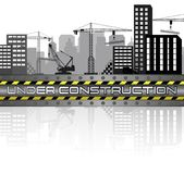 Εργοτάξια οικοδομής με τα κτήρια και τους γερανούς Στοκ φωτογραφία με δικαίωμα ελεύθερης χρήσης