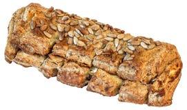 Εσωτερική ακέραια σκοτεινή φραντζόλα ψωμιού που ψεκάζεται με τους σπόρους ηλίανθων που απομονώνονται στο άσπρο υπόβαθρο Στοκ εικόνες με δικαίωμα ελεύθερης χρήσης