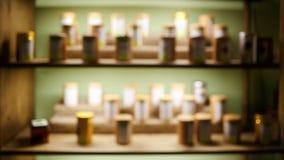 Εσωτερικό θολωμένο αφηρημένο υπόβαθρο καφετεριών τσαγιού, ράφια με τα δείγματα, πίσω φως assuage στοκ φωτογραφίες