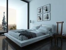 Εσωτερικό κρεβατοκάμαρων με τα σύγχρονα έπιπλα και το κρεβάτι Στοκ Εικόνες