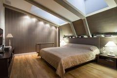 Εσωτερικό μιας αληθοφανούς κρεβατοκάμαρας πολυτέλειας Στοκ Εικόνες