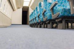 Εσωτερικό του ηλεκτρικού τραίνου με την επιχείρηση άδειων θέσεων transportat Στοκ εικόνα με δικαίωμα ελεύθερης χρήσης