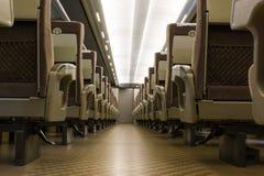 Εσωτερικό του ηλεκτρικού τραίνου με την επιχείρηση άδειων θέσεων transportat Στοκ Φωτογραφία