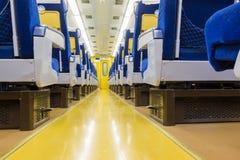 Εσωτερικό του ηλεκτρικού τραίνου με την επιχείρηση άδειων θέσεων transportat Στοκ Εικόνα