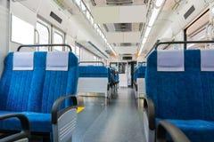 Εσωτερικό του τραίνου με την επιχειρησιακή μεταφορά άδειων θέσεων Στοκ Εικόνα