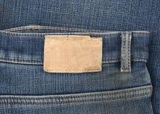 Ετικέτα τζιν δέρματος που ράβεται το τζιν παντελόνι Στοκ φωτογραφία με δικαίωμα ελεύθερης χρήσης