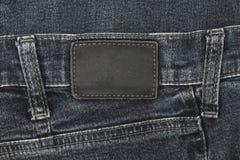Ετικέτα τζιν που ράβεται στα μαύρα τζιν Στοκ Εικόνες