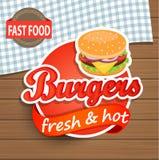 Ετικέτα Burgers στο ξύλινο υπόβαθρο Στοκ εικόνες με δικαίωμα ελεύθερης χρήσης