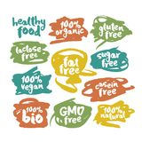 Ετικέτες τροφίμων Vegan Eco που τίθενται στις ζωηρόχρωμες κακογραφίες Στοκ φωτογραφία με δικαίωμα ελεύθερης χρήσης