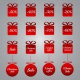 Ετικέττες τιμολόγησης Χριστουγέννων - κόκκινες μορφές δώρων και μπιχλιμπιδιών Στοκ Φωτογραφίες