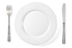 λευκό πιάτων μαχαιριών δικ& Στοκ Εικόνες