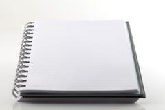 λευκό σημειώσεων βιβλίω& Στοκ Φωτογραφία