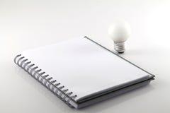 λευκό σημειώσεων βιβλίω& Στοκ Φωτογραφίες
